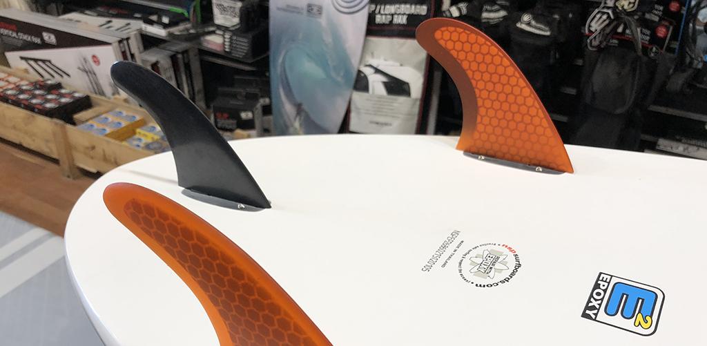 Choosing Surfboard Fins Stiff Side Fins Soft Rear Fin