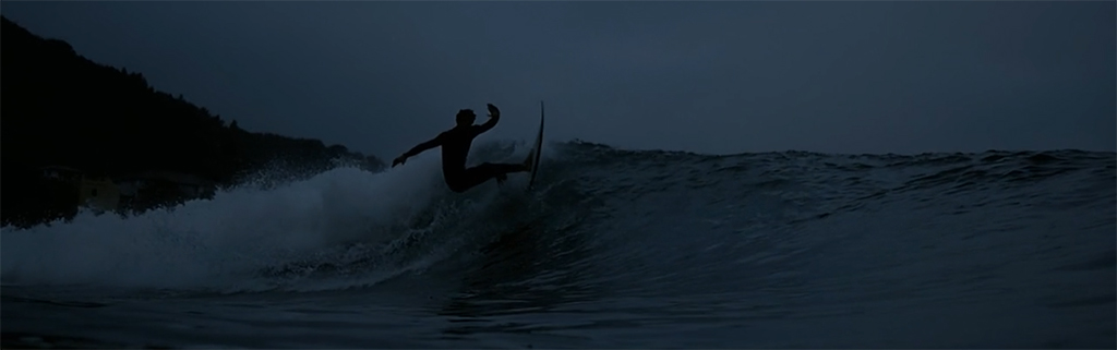 ION Wetsuits On Dark Surfing